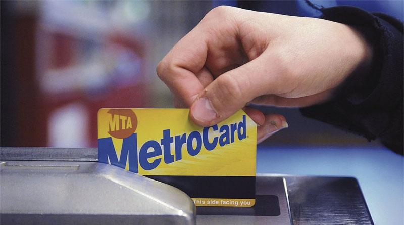 metrocard being swiped at turnstile