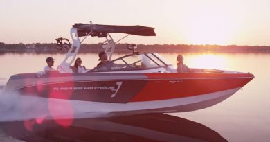 wakeboard boat at sunset in flat water